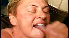 A fat old grandmother kneels and services a stiff cock